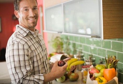 Man eating fruit