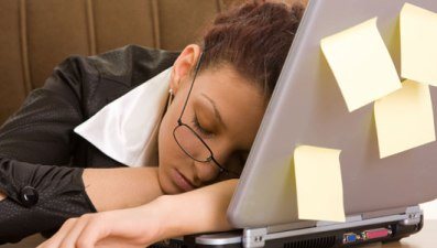 Woman tired at computer