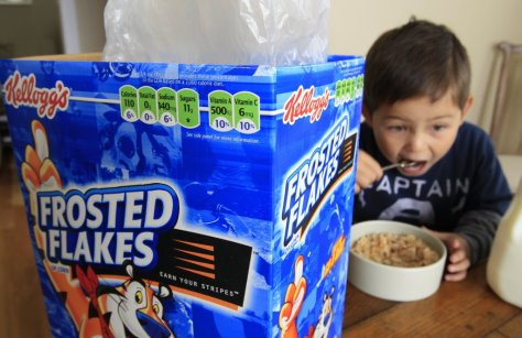 Child eating Frosted Flakes
