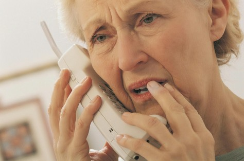 Worried elderly woman