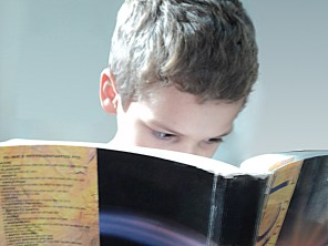 Young Boy Reading Eye Strain