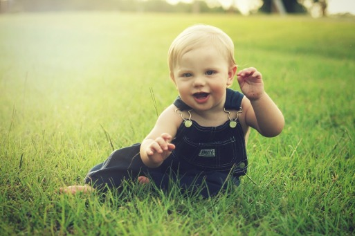 Infant Playing in Grass