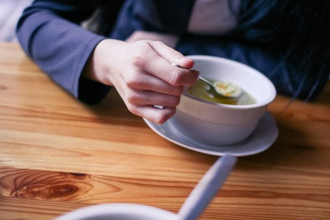 person eating soup