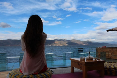 Woman ocean thinking