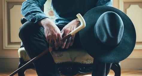 man-sitting-cane