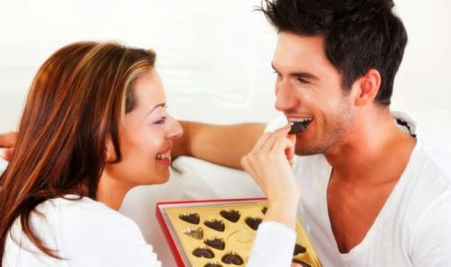 Couple eating chocolate
